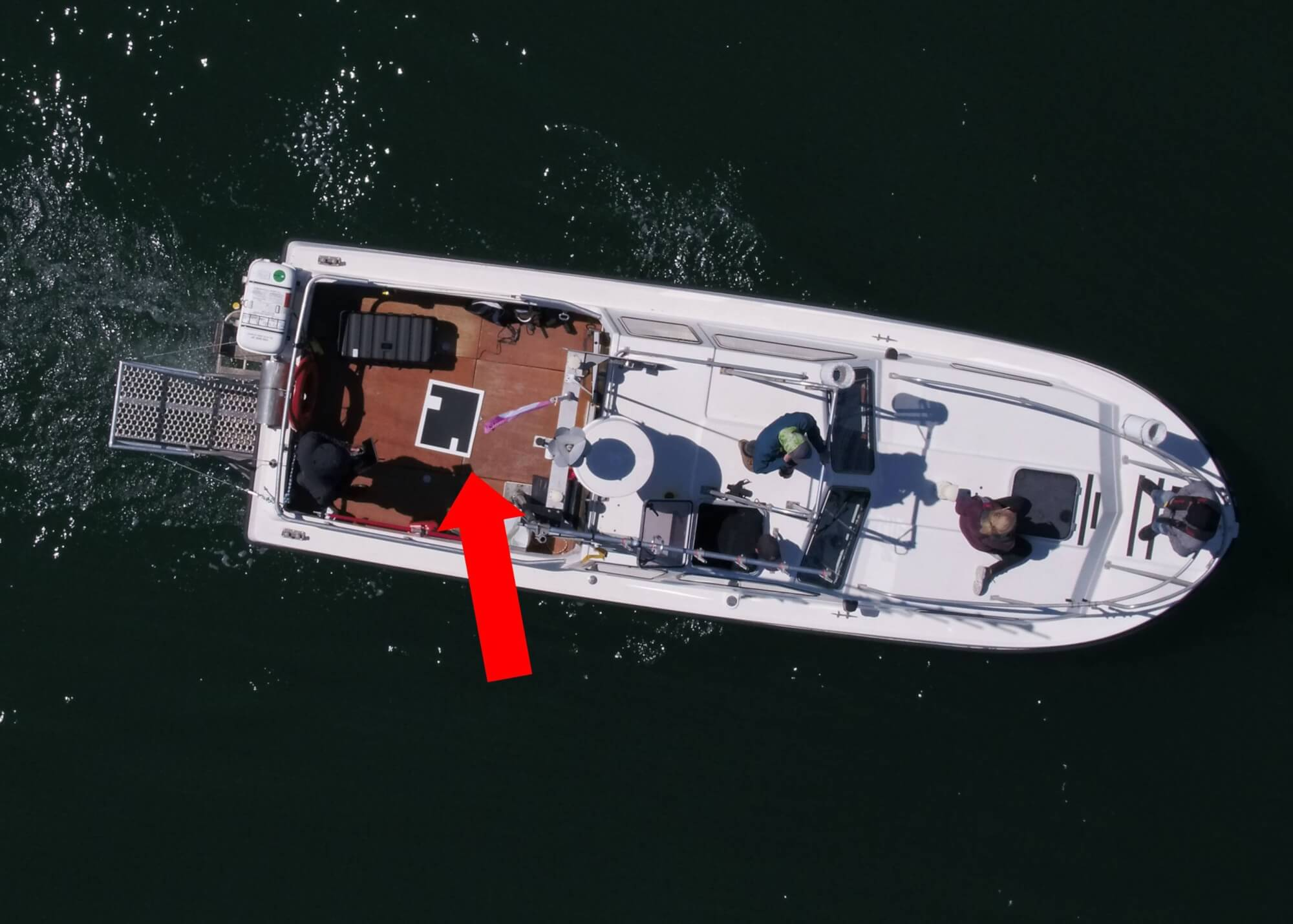 Aerial view of the research ship, with black cardboard and white square on it